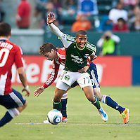 CARSON, CA – June 3, 2011: Portland Timbers defender Jeremy Hall (17) shields the ball from Chivas USA midfielder Jorge Flores (19) during the match between Chivas USA and Portland Timbers at the Home Depot Center in Carson, California. Final score Chivas USA 1, Portland Timbers 0.