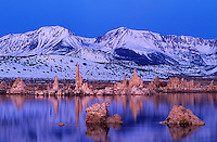 761950056 a winter sunrise lights up the tufas and the snow covered eastern sierras on a quiet morning at mono lake state park california
