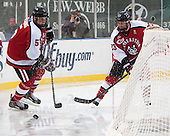 Matt Benning (NU - 5), Colton Saucerman (NU - 23) - The Northeastern University Huskies defeated the University of Massachusetts Lowell River Hawks 4-1 (EN) on Saturday, January 11, 2014, at Fenway Park in Boston, Massachusetts.