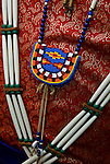 "Pow wow dancers regalia, bead work at the Thunderbird Powwow at the Queens County Farm Museum ....A pow-wow (also powwow or pow wow or pau wau) is a gathering of North America's Native people. The word derives from the Narragansett word powwaw, meaning ""spiritual leader""."
