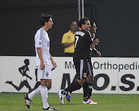 D.C. United midfielder Andy Najar (14) celebrates with teammate Dwayne De Rosario (7) his score in the 48th minute of the game. D.C. United defeated The Vancouver Whitecaps FC 4-0 at RFK Stadium, Saturday August 13 , 2011.