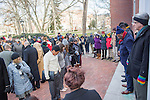 The Rev. Evan Young, a campus minister at United Campus Ministry and a member of the MLK Celebration week planning committee, speaks to a crowd outside of Galbreath Chapel before the Silent March on January 18, 2016. Photo by Emily Matthews