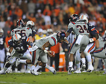 Ole Miss quarterback Randall Mackey (1) is sacked by  Auburn linebacker Eltoro Freeman (21) at Jordan-Hare Stadium in Auburn, Ala. on Saturday, October 29, 2011. .