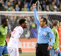 November, 2013: CenturyLink Field, Seattle, Washington: Portland Timbers defender/midfielder Rodney Wallace (22) complains while getting a yellow card from referee Baldomero Toledo as the Portland Timbers take on the Seattle Sounders FC in the Major League Soccer Playoffs semifinals Round. Portland won the first match 2-1.