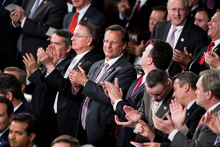 UNITED STATES - FEBRUARY 28: Rep. Dave Brat, R-Va., and fellow Republicans clap as President Donald Trump delivers his address to a joint session of Congress on Tuesday, Feb. 28, 2017. (Photo By Bill Clark/CQ Roll Call)