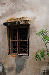 An ancient window in Dapeng Fortress stares into space on a barren wall with its perfect shadows and highlights. This photograph strongly gives the illusion of a painting.