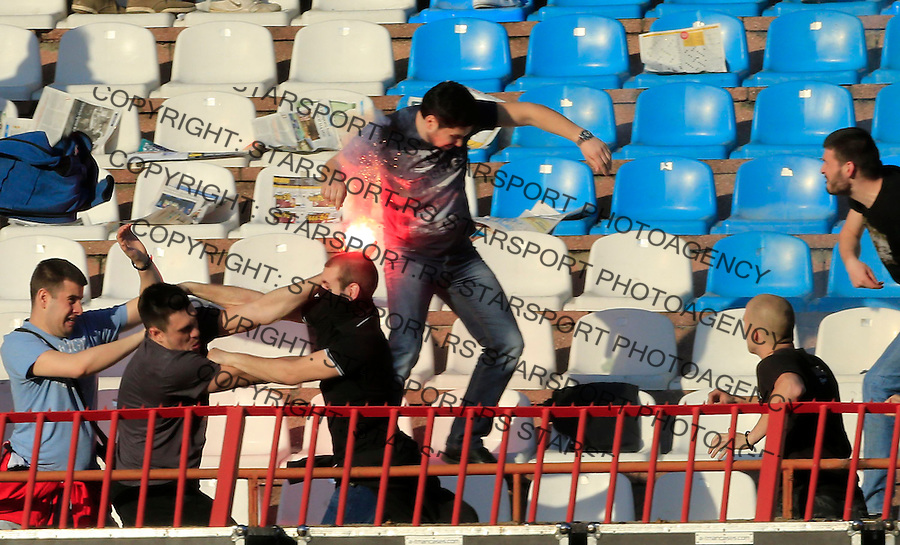 BELGRADE, SERBIA - APRIL 25: Red Star soccer fans (L) clash with Partizan fans during the Serbian Super League match between FK Crvena Zvezda and FK Partizan at stadium Rajko Mitic on April 25, 2015 in Belgrade, Serbia. (Photo by Srdjan Stevanovic/Getty Images)