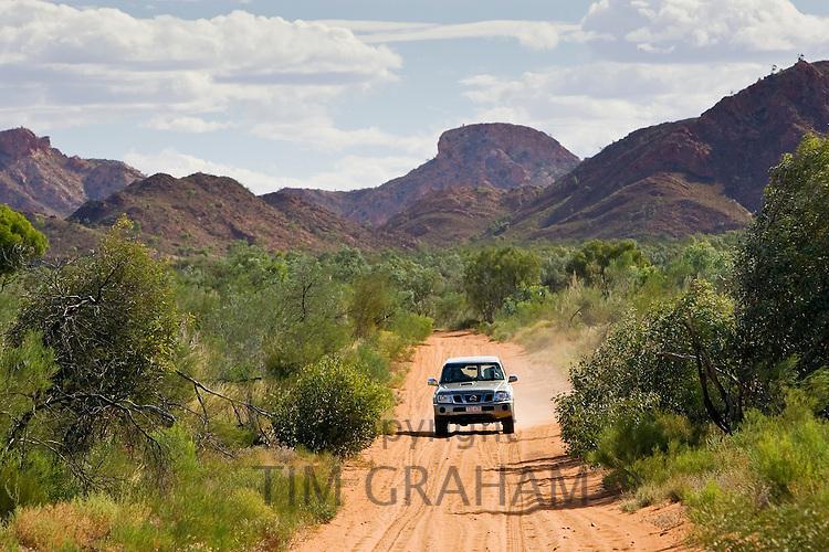 Four-wheel-drive vehicle on the Mereenie-Watarrka Road,  Gosse Bluff, Red Centre, Australia