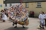 Hunting the Earl of Rone. Combe Martin Devon England<br />   2011.  The Hobby Horse dancing through the streets of the village.
