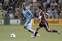 C. J Sapong (17) forward Sporting KC goes past Ryan Guy..Sporting Kansas City and New England Revolution played to a 0-0 tie at LIVESTRONG Sporting Park, Kansas City, KS.