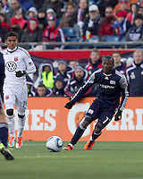 New England Revolution forward Kheli Dube (11) passes the ball. In a Major League Soccer (MLS) match, the New England Revolution defeated DC United, 2-1, at Gillette Stadium on March 26, 2011.z