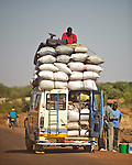 An overloaded van by the side of the road in Mali, West Africa.