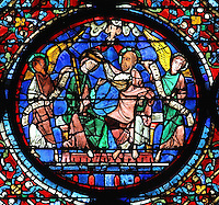 Mary is crowned by Jesus and shares his throne, they are flanked by 2 angels holding the words of the Te Deum, and above, the dove of the Holy Spirit releases 2 tongues of fire representing love. The Coronation of the Virgin, from the Glorification of the Virgin stained glass window, in the nave of Chartres Cathedral, Eure-et-Loir, France. This window depicts the end of the Virgin's life on earth, her dormition and assumption, as told in the apocryphal text the Golden Legend of 1260. Chartres cathedral was built 1194-1250 and is a fine example of Gothic architecture. Most of its windows date from 1205-40 although a few earlier 12th century examples are also intact. It was declared a UNESCO World Heritage Site in 1979. Picture by Manuel Cohen