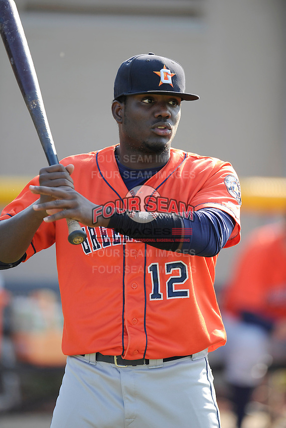 Right fielder Ydarqui Marte (12) of the Greeneville Astros warms up before a game against the Bristol Pirates on Saturday, July 26, 2014, at DeVault Memorial Stadium in Bristol, Virginia. Greeneville won, 2-1 in Game 1 of a doubleheader. (Tom Priddy/Four Seam Images)