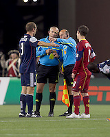 After discussion, Real Salt Lake midfielder Will Johnson (8) receives second yellow card, ejection. In a Major League Soccer (MLS) match, Real Salt Lake defeated the New England Revolution, 2-0, at Gillette Stadium on April 9, 2011.