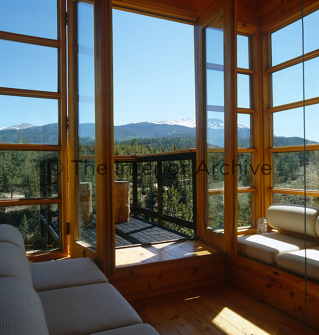 The spectacular view from this Colorado retreat takes in the Collegiate Mountains and native forests that surround the Arkansas River valley
