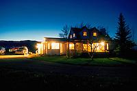 Farm home at dusk, interior lights