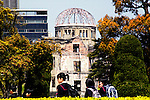 Schoolchildren walk in front of the A-Bomb Dome in Hiroshima, Japan. .The A-Bomb Dome is the skeletal ruins of what was, before the world's first nuclear attack on Aug. 6 1945,  the city's Industrial Promotion Hall. Although the building was the closest to the hypocenter of the nuclear bomb, its basic structure remained standing and has been preserved in the state it was found after the bombing. Like Kyoto, Hiroshima is an almost mandatory school trip for Japanese junior high school students.