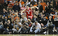 Ohio State Buckeyes guard Aaron Craft (4) jumps over the press photographer back into the game after saving the ball during the second half of his NCAA Mens East Regional finals game against the Syracuse Orange at  the TD Banknorth Garden in Boston, Massachusetts, March 24, 2012.  (Photo by Neal C. Lauron)