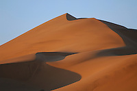 Tsorob Dune in the Central Namib Desert, Namibia. The Namib dunes are formed by the powerful force of desert winds that gradually push the dunes in a north-westerly direction.