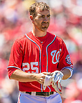 26 May 2013: Washington Nationals first baseman Adam LaRoche removes his batting gloves during a game against the Philadelphia Phillies at Nationals Park in Washington, DC. The Nationals defeated the Phillies 6-1 to take the rubber game of their 3-game weekend series. Mandatory Credit: Ed Wolfstein Photo *** RAW (NEF) Image File Available ***