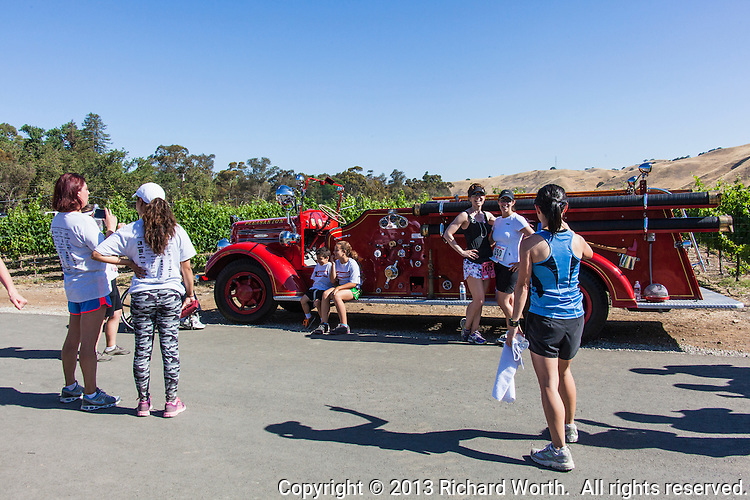 Paticipants and spectators pose with antique fire apparatus displayed during the Hook and Ladder run at the Wente Winery in Livermore, CA which supports injured and fallen Firefighters, Burn Foundation and Local Charities in the Tri Valley .