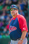 8 July 2014: Lowell Spinners Manager Joe Oliver coaches third base against the Vermont Lake Monsters at Centennial Field in Burlington, Vermont. The Lake Monsters rallied in the 9th inning to defeat the Spinners 5-4 in NY Penn League action. Mandatory Credit: Ed Wolfstein Photo *** RAW Image File Available ****