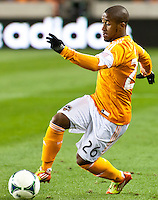 Corey Ashe of the Dynamo, tries to control the ball during the second half at BBVA Compass Stadium. Houston beat D.C United, 2-0 in the MLS season opener.