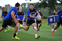Brett Herron of Bath Rugby looks to pass the ball. Bath Rugby training session on August 4, 2015 at Farleigh House in Bath, England. Photo by: Patrick Khachfe / Onside Images