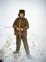The Khan's son is taking the yaks out, scaring them off with a sling shot..Winter expedition through the Wakhan Corridor and into the Afghan Pamir mountains, to document the life of the Afghan Kyrgyz tribe. January/February 2008. Afghanistan