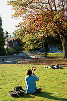 Man playing a trombone in Grandview Park, Vancouver, British Columbia, Canada