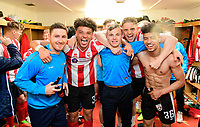 Lincoln City's lead sports scientist Luke Jelly, left, with players, (from left) Lee Angol, Harry Anderson, Callum Howe, and Josh Ginnelly celebrate in the changing room after the game<br /> <br /> Photographer Chris Vaughan/CameraSport<br /> <br /> Vanarama National League - Lincoln City v Macclesfield Town - Saturday 22nd April 2017 - Sincil Bank - Lincoln<br /> <br /> World Copyright &copy; 2017 CameraSport. All rights reserved. 43 Linden Ave. Countesthorpe. Leicester. England. LE8 5PG - Tel: +44 (0) 116 277 4147 - admin@camerasport.com - www.camerasport.com
