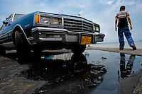 An American classic car from 1970s seen parked on the bank of the lake Maracaibo in Maracaibo, Venezuela, 10 May 2006.