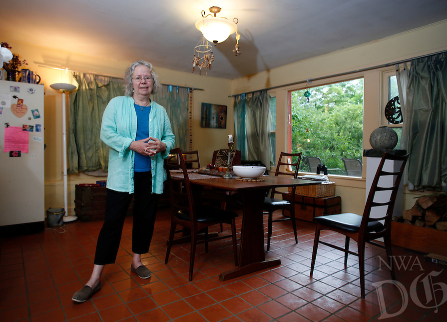 NWA Democrat-Gazette/DAVID GOTTSCHALK - 5/28/15 - Jo Ann Kaminsky in her favorite personal space Thursday May 28, 2015, the dining area in her Fayetteville home.