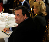 Governor Chris Christie (Republican of New Jersey) attends the National Governors Association meeting in the White House State Dining Room with Governor Jan Brewer (Republican of Arizona) on Monday, February 27, 2012, in Washington, DC. .Credit: Leslie E. Kossoff / Pool via CNP