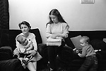 Derry Northern Ireland Londonderry. 1983. Ann Doherty and Marie McSheffrey with their children. Papers concern their husbands future trials. They have help from CAST, Campaign Against Show Trials.