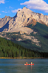 Canoe on Maligne Lake under Mount Sampson, Jasper National Park, Alberta, Canada.