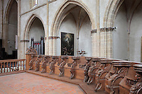 Carved wooden choir stalls with human heads and goats under the armrests, in Saint Volusian Abbey, or the Abbatiale Saint-Volusien, in Foix, Ariege, Midi-Pyrenees, France. The 26 choir stalls  were acquired in 1804 from Saint-Sernin church, and were built in 1670 for the chapter of Toulouse. The original abbey church was built in the 12th century, but was later destroyed and rebuilt in the 17th century. The abbey houses the relics of St Volusian, 7th bishop of Tours, who died c. 495 AD, and its buildings now house the Prefecture of the Ariege. Picture by Manuel Cohen