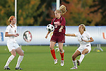 05 November 2008: Virginia Tech's Emily Jukich (10) plays the ball between Florida State's Tori Huster (9) and Sarah Wagenfuhr (5). Virginia Tech and Florida State University played to a 0-0 tie after two overtimes at Koka Booth Stadium at WakeMed Soccer Park in Cary, NC in a women's ACC tournament quarterfinal game.  Virginia Tech advanced to the semifinal round in penalty kicks, 4-2.