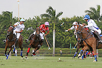 WELLINGTON, FL - MARCH 05: Facundo Pieres of Orchard Hill (Red) and Diego Cavanagh of Valiente battle for the ball, while Adolfo Cambiaso and Bob Jornayvaz of Valiente look on as Valiente defeats Orchard Hill 14-11, in the 26 goal CV Whitney Cup Final, at the International Polo Club, Palm Beach on February 26, 2017 in Wellington, Florida. (Photo by Liz Lamont/Eclipse Sportswire/Getty Images)