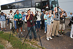 Urban birding...a bus load of birders from the Rio Grande Valley Birding Festival check out a San Benito neighborhood for wild green parakeets.  Tours include canoe and pontoon boat trips, neighborhood birding, and visits to refuges, World Birding Centers and private ranches in search of the varied, colorful and sometimes rare birds of south Texas.