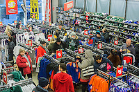 Bargains hunters clamber over racks of discounted merchandise in the Modell's Grand Central location in New York on Wednesday, February 18, 2015. After 25 years there is only one week to go after the loss of its lease due to the construction of a skyscraper as part of redevelopment of Midtown East.  Several other retailers have already vacated. (© Richard B. Levine)
