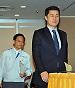May 9th, 2011, Tokyo, Japan - Goshi Hosono, right, a special adviser to Japanese Prime Minister Naoto Kan, and Hidehiko Nishiyama, deputy director-general of Japan Nuclear and Industry Safety Agency, arrive for a news conference at Tokyo Foreign Correspondent Club of Japan to update the development at the quake-hit Fukushima No. 1 nuclear plant during on Monday, May 9, 2011. Eight workers of Tokyo Electric Power Co. and a government inspector entered the reactor building of the No. 1 unit early Monday to survey conditions inside and measured radiation levels. (Photo by Natsuki Sakai/AFLO) [3615] -mis-..