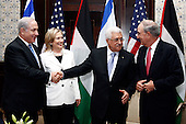 Prime Minister Benjamin Netanyahu of Israel(first from left), United States Secretary of State Hillary Rodham Clinton (second from left), President Mahmoud Abbas of the Palestinian Authority (third from left), and U.S. Special Envoy for Middle East Peace George C. Mitchell (fourth from left) chat after their meeting in Sharm El Sheikh, Egypt, on Tuesday, September 14, 2010..Credit: Department of State via CNP.