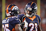 SHOT 10/19/14 7:30:28 PM - Denver Broncos starting cornerback duo Chris Harris Jr. #25 and Aqib Talib #21 celebrate a defensive stop against the San Francisco 49ers at Sports Authority Field at Mile High Sunday October 19, 2014 in Denver, Co. The Broncos beat the 49ers 42-17.<br /> (Photo by Marc Piscotty / &copy; 2014)