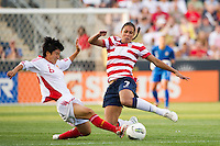 Shannon Boxx (7) of the United States (USA) and Ren Guixin (6) of China (CHN). The United States (USA) women defeated China PR (CHN) 4-1 during an international friendly at PPL Park in Chester, PA, on May 27, 2012.