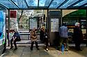 Edinburgh, UK. 15.04.2017. People wait for a bus on Princes Street. Photograph © Jane Hobson.