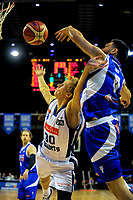 Shea Ili blocks Kyle Adnam's layup during the national basketball league match between Wellington Saints and Nelson Giants at TSB Bank Arena in Wellington, New Zealand on Tuesday, 25 April 2017. Photo: Dave Lintott / lintottphoto.co.nz