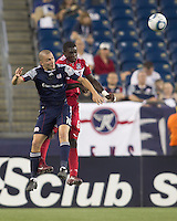 New England Revolution forward Rajko Lekic (10) and Chicago Fire defender Jalil Anibaba (6) battle for head ball. In a Major League Soccer (MLS) match, the New England Revolution tied the Chicago Fire, 1-1, at Gillette Stadium on June 18, 2011.