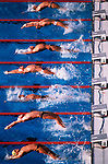 Swimmers leave the blocks at the start of a backstroke race at the 1984 Los Angeles Olympics. This image was part of an enry that was awarded the 1985 Pulitzer Prize for Spot News Photography.